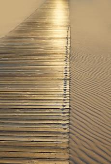 Beach wooden walkway and sand dunes texture