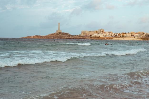 Beachfront lighthouse in murcia on the mediterranean sea on the beach