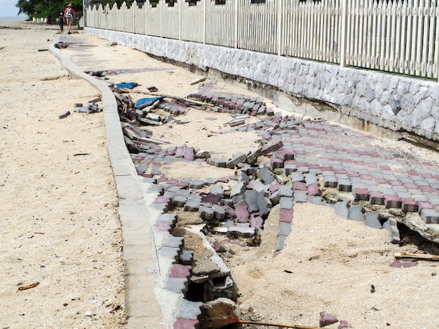 Beachfront road boardwalk damaged by storm surge