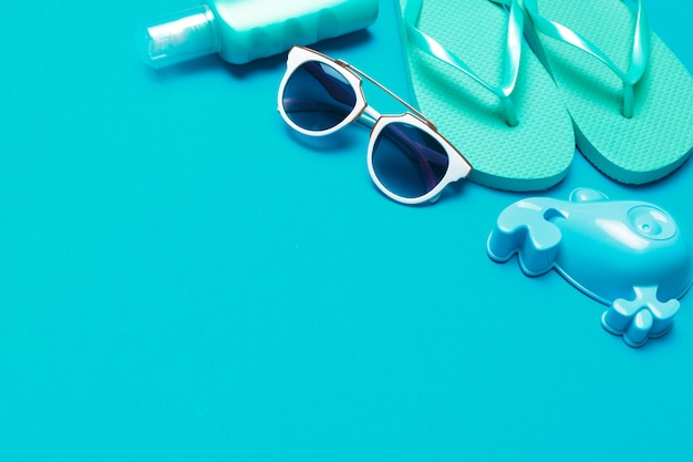 Beachwear and accessories on a blue background