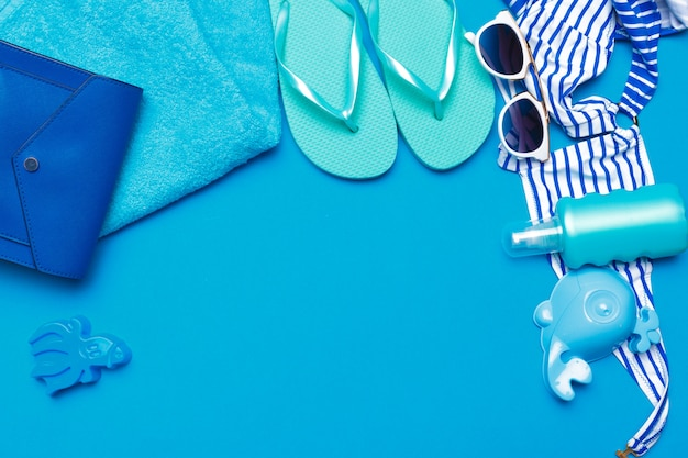 Beachwear and accessories on a blue
