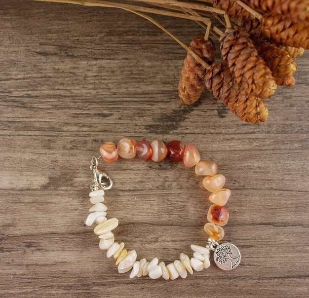 Beaded bracelet on wooden background flat lay,top view