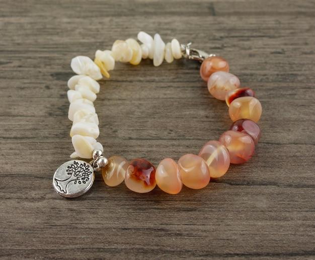 Beaded bracelet on wooden background