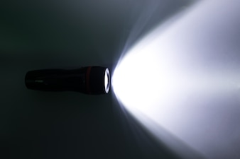 Beam of a flashlight on a white background