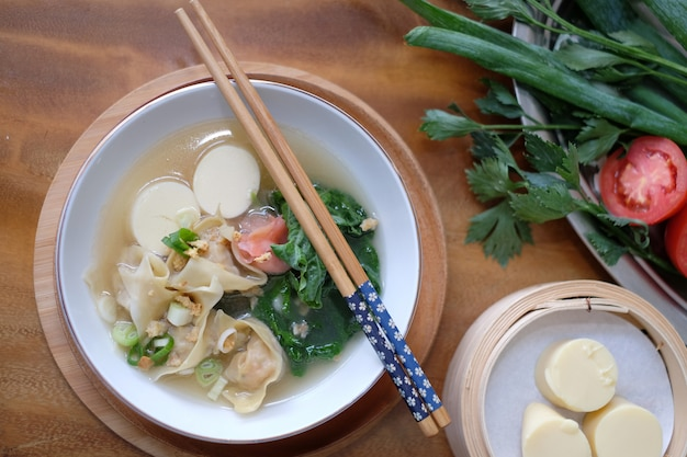 Beancurd tofu soup with chopstick