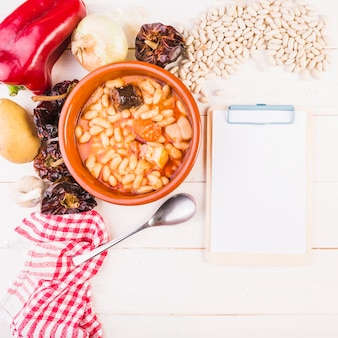 Beans dish with groceries and clipboard