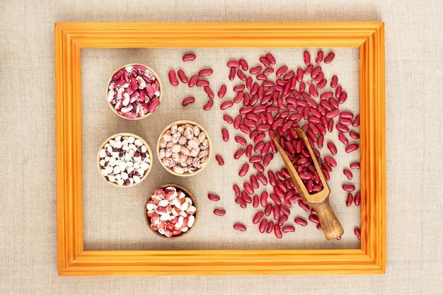 Фасоль разного цвета в портретной рамке