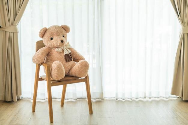 Bear doll on chair
