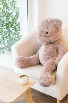 Bear doll sit on sofa