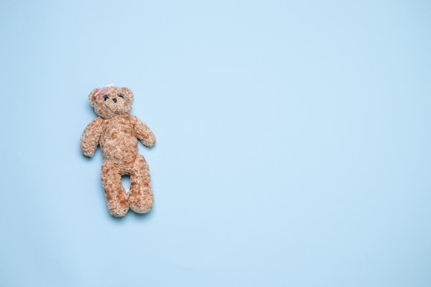 Bear toy over blue background with copy space top view, flat lay