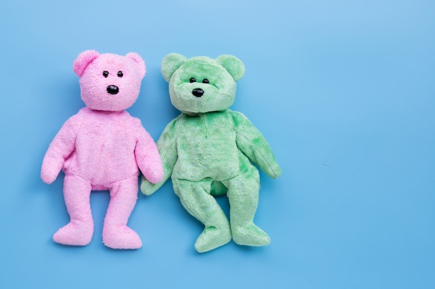 Bear toy couple on blue background.