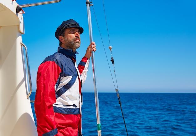 Beard sailor man sailing sea in a boat captain cap