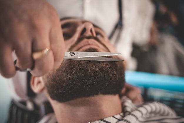 Beard styling and cut.