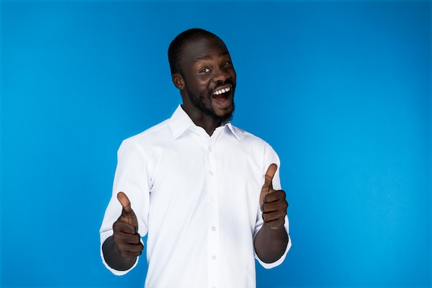 Bearded afroamerican guy with thumbs up is laughing