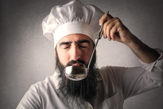 Bearded arabic tasting a soup