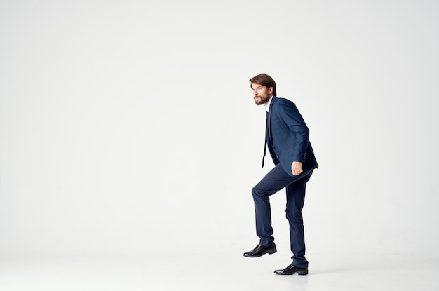 Bearded business man emotions successful light background