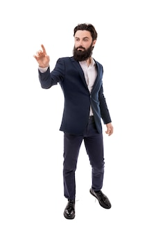 Bearded businessman, hand touching empty virtual screen, isolated on white background