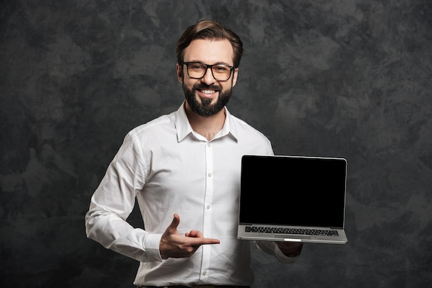 Bearded businessman showing display of laptop