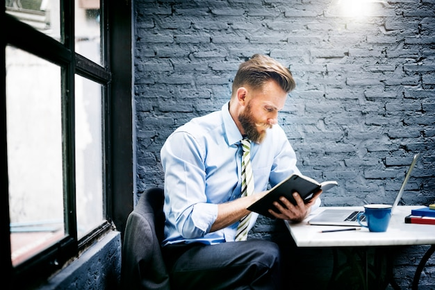 Bearded businessman taking notes