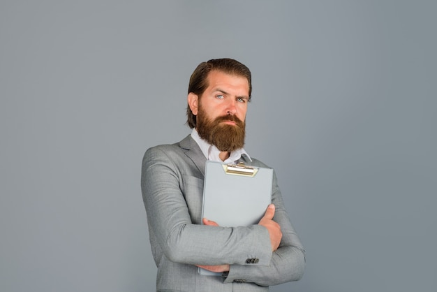 Bearded businessman with folder business man wearing formal suit holds notebook businessman holds