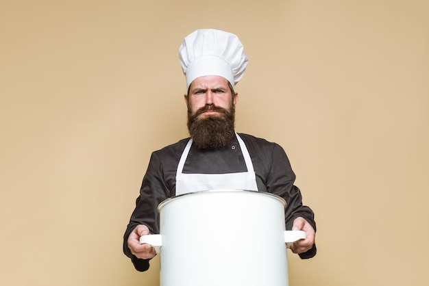 Bearded chef with big pot cooking bearded chef in uniform kitchenware cook kitchen food