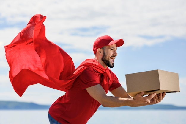Bearded delivery man wearing superhero cape
