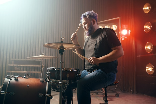 Bearded drummer with colorful hair