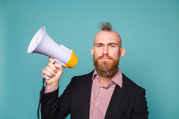 Bearded european businessman in dark suit isolated, with megaphone