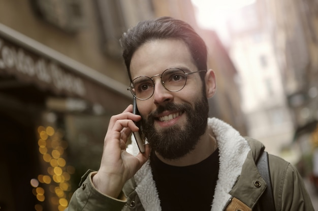Bearded guy talking on a smartphone