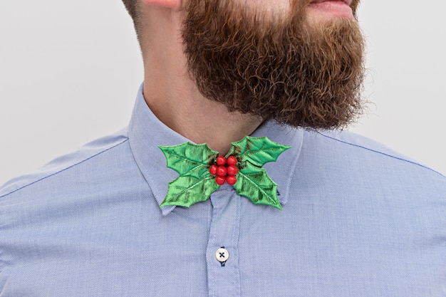 Bearded hipster with festive christmas bow tie
