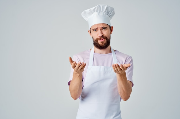 Bearded male chef with saucepan in hands kitchen restaurant professional