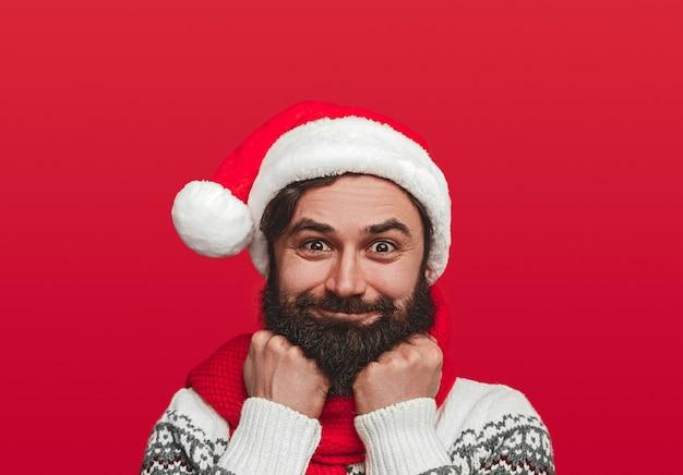 Bearded male hipster in santa hat