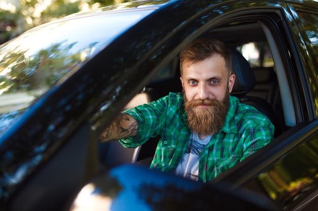 Bearded man in the car