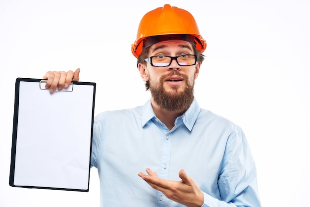 Bearded man documents in hand and drawings studio hand gesture