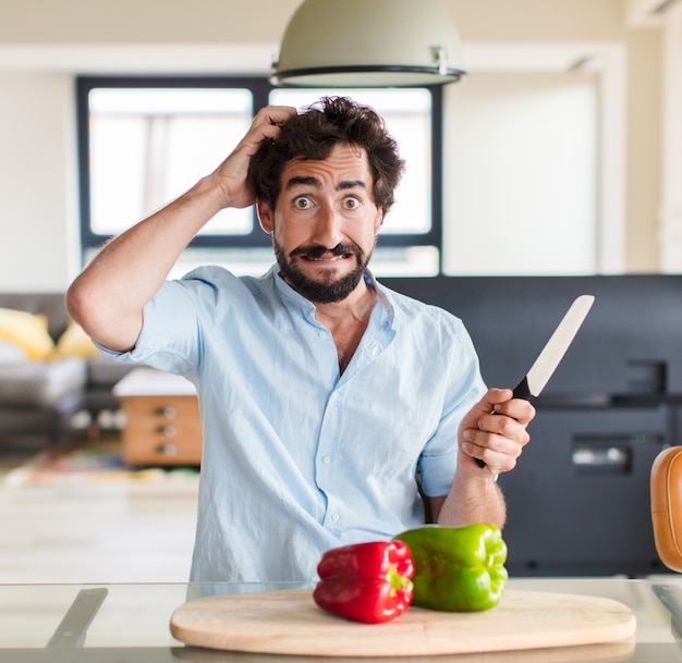 Bearded man feeling stressed, worried, anxious or scared, with hands on head, panicking at mistake