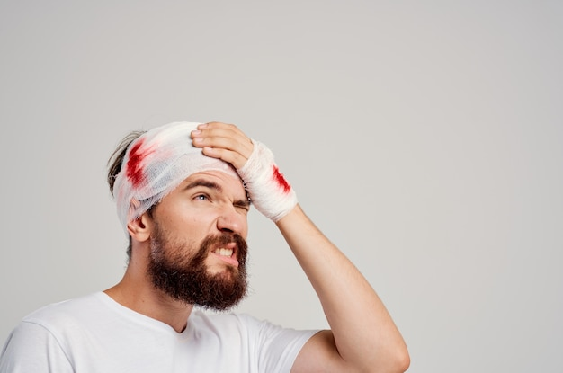 Bearded man head and arm injuries health problems isolated background