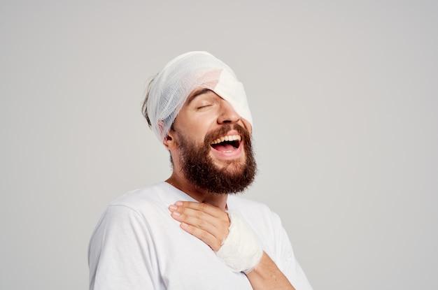 Bearded man head injury in white tshirt headache hospital medicine
