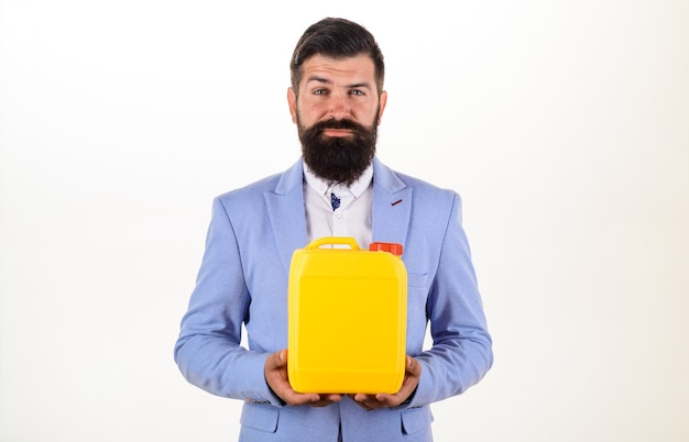Bearded man holds can in supermarket shop or diy department store man holds petrol canister
