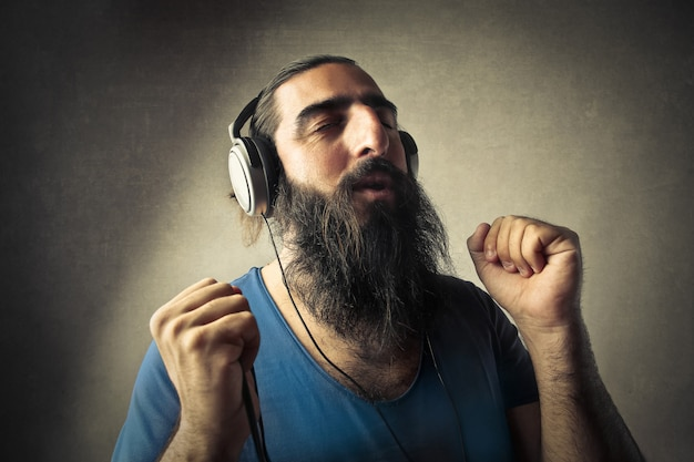 Bearded man listening to music