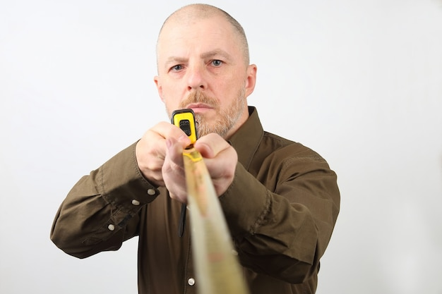 Bearded man makes a measurement tape measure centimeter