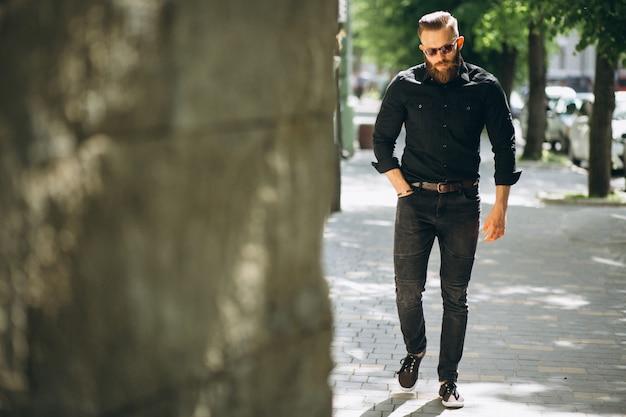 Bearded man model in the street