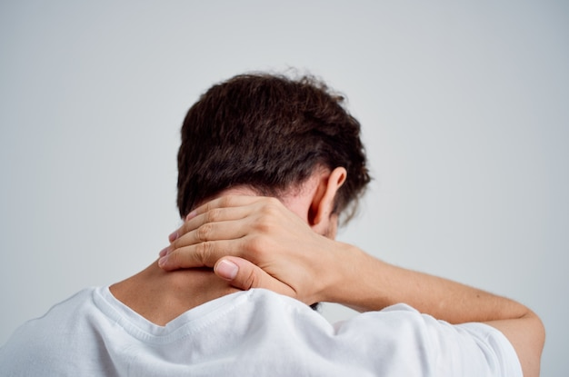 Bearded man pain in the neck health problems massage therapy isolated background