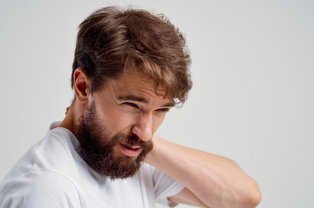 Bearded man pain in the neck health problems massage therapy studio treatment