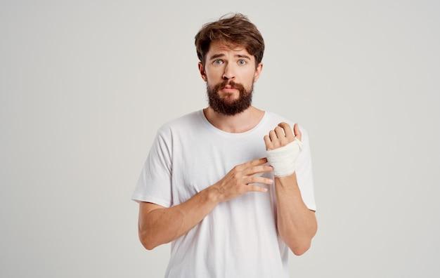 Bearded man on patient bandaged hand health problems hospital medicine