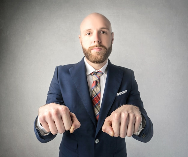 Bearded man playing fist hiding game
