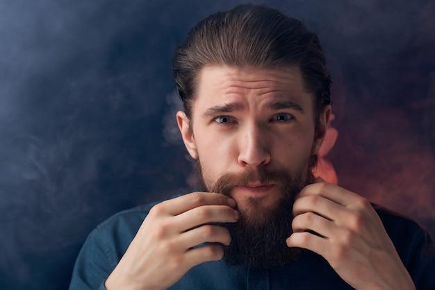 Bearded man posing fashion closeup studio