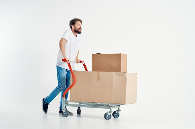 Bearded man shipping transport in a box light background