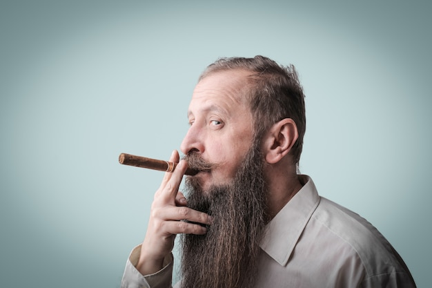 Bearded man smoking a cigar