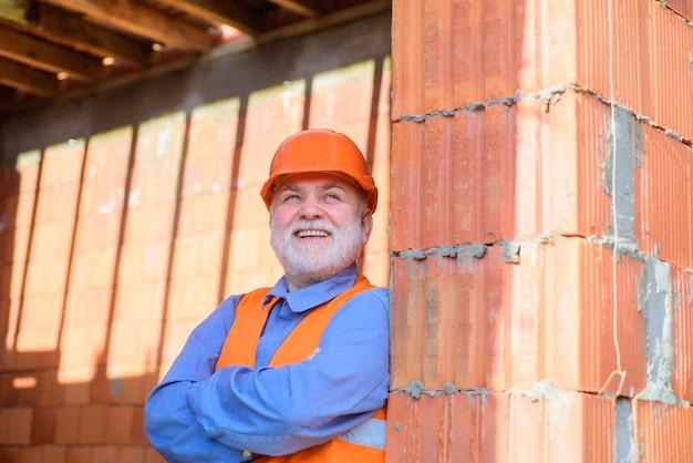 Bearded man in suit with construction helmet portrait of handsome engineer construction worker in