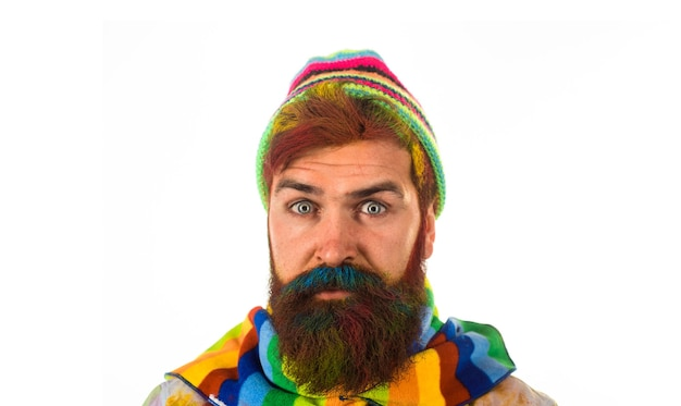 Bearded man in trendy colorful scarf and hat autumnal vogue trend bearded man in autumn style